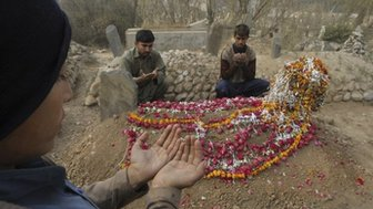 A funeral for a school victim in Peshawar, 19 December