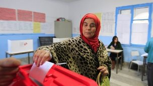A Tunisian votes in the presidential election, 21 December 2014