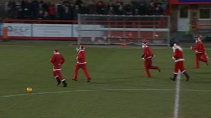 Father Christmases invading pitch