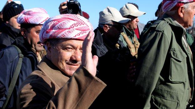 Kurdistan Iraqi regional government President Massoud Barzani arrives to support Kurdish forces as they head to battle Islamic State militants, on the summit of Mount Sinjar, in the town of Sinjar, Iraq, Sunday, Dec. 21, 2014.