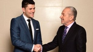 The winner of the latest series of the BBC programme The Apprentice Mark Wright celebrates with Lord Sugar in London