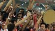 Atletico de Kolkata player Luis Garcia lifts the trophy as he celebrates with teammates after winning the Indian Super League (ISL) final football match against Kerala Blasters at The D.Y. Patil stadium in Navi Mumbai on December 20, 2014
