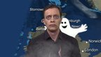 Weather presenter with ghost behind him