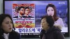 TV screen in Seoul showing news report of film The Interview. 22 Dec 2014