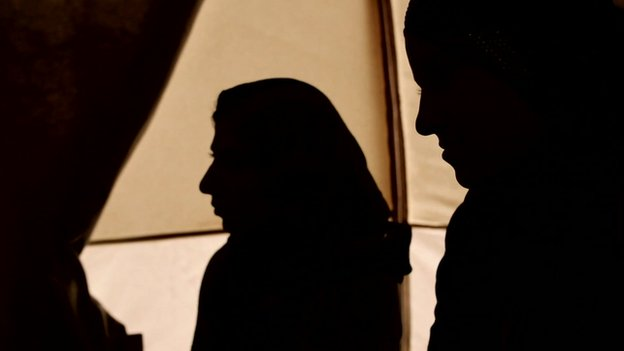 Yazidi women in silhouette