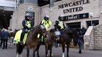 Police officers on horseback