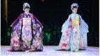 Models wearing bridal kimonos at a fashion show