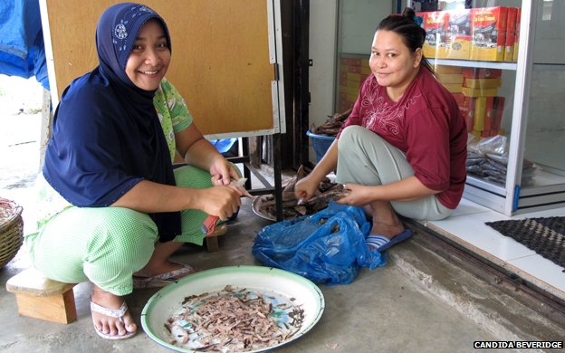 Women making fish snacks