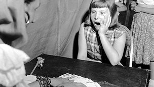 Fortune teller and astounded girl