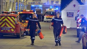 Firemen walk on the site where a the driver of a van (seen in picture) ploughed into a Christmas market injuring at least ten people before stabbing himself in the western French city of Nantes, 22 December 2014
