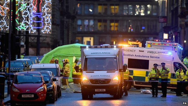 Emergency services attend the scene of the crash in George Square