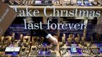 """""""make Christmas last forever"""" sign in shop window"""