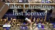 """make Christmas last forever"" sign in shop window"
