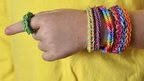 Boy wearing loom bands