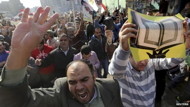 Supporters of ousted President Mohammed Morsi protest against the military and interior ministry in Cairo, Egypt (28 November 2014)