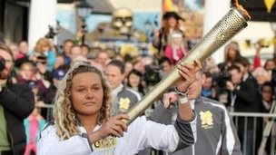 Tassie Swallow holding the Olympic torch