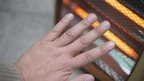 hand in front of fire