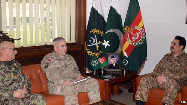 Pakistani army chief Raheel Sharif (right) meets Afghan army chief General Sher Mohammad Karimi (left) and General John Campbell (centre),  Isaf commander, during a meeting at General Headquarters in Pakistan, 23 December 2014