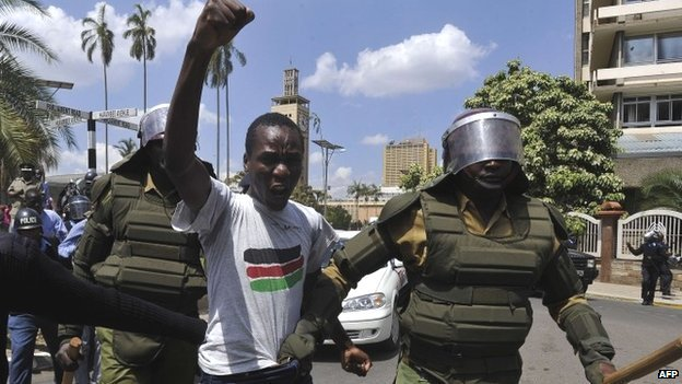 Policemen arrest a man protesting against controversial new security legislation in Nairobi, Kenya - 18 December 2014