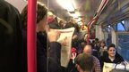 Commuters on a Thameslink train