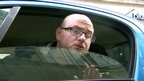 Matthew Sanders who is in a parking dispute with Birmingham City Council speaking through his car window