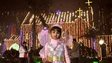 A young Indian girl, dressed as an angel, poses in front of the illuminated Golak Nath church in Jalandhar on December 24, 2014.