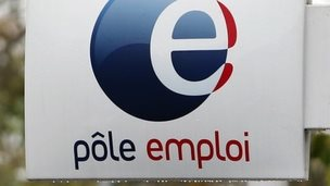 logo is seen on the entrance of a Pole Emploi office (National Agency for Employment)