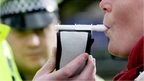 Woman being breathalysed