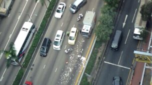 A shot from above the road in the Wan Chai district of Hong Kong, where the money spilled on to the street - 24 December 2014