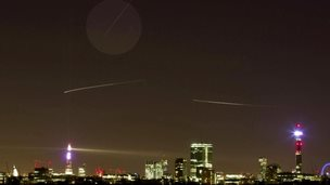 The path of The International Space Station (top straight line) is seen from central London on December 24