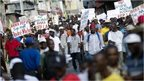 Anti-government protesters march through Port-au-Prince