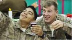 U.S. soldiers from the 3rd Cavalry Regiment pose for a photograph while eating a Christmas day lunch at forward operating base Gamberi in the Laghman province of Afghanistan December 25, 2014