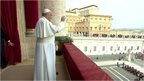 Pope Francis on the balcony overlooking St Peter's Square