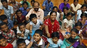 The couple look after more than 30 children