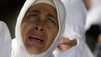 A woman cries at a mass grave in Banda Aceh, Indonesia. Photo: 26 December 2014