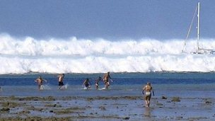 File photo dated 26 December 2004 shows tourists caught by the first of six tsunami rolling towards Hat Rai Lay Beach, near Krabi in southern Thailand