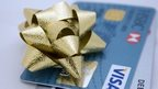Christmas ribbon rosette on a credit card