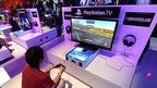 File picture shows people testing the new PlayStation TV consoles in LA (June 2014)