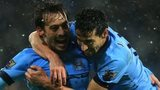 David Silva celebrates with Jesus Navas after scoring Manchester City's third goal