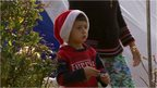 A young Iraqi boy wearing a Santa hat