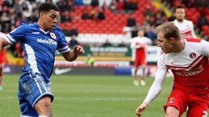 Tom Adeyemi of Cardiff City on the attack against Charlton