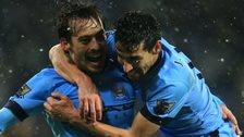 David Silva celebrates with Jesus Navas after scoring Manchester City's third goal