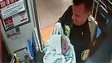 Police sergeant holds baby born on train in Philadelphia (25 Dec)