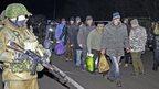 Ukrainian prisoners of war arrive at the exchange place of pro-Russian rebels and Ukrainian troops near Donetsk. Photo: 26 December 2014