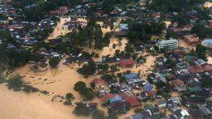 houses submerged in floodwaters in Pengkalan Chepa, near Kota Bharu on December 27, 2014
