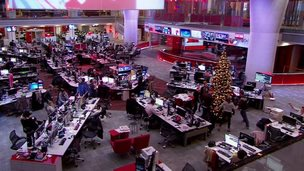BBC staff dance around the Christmas tree