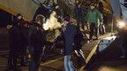 Ukrainian President Petro Poroshenko greets returning prisoners at an airport near Kiev, 27 December
