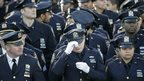 Police officers outside Christ Tabernacle Church in Queens, New York, 27 December