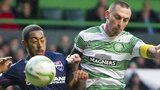 Ross County's Jamie Reckord and Celtic's Scott Brown battle for the ball.