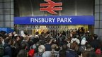 Crowds of passengers queue outside Finsbury Park Station in north London